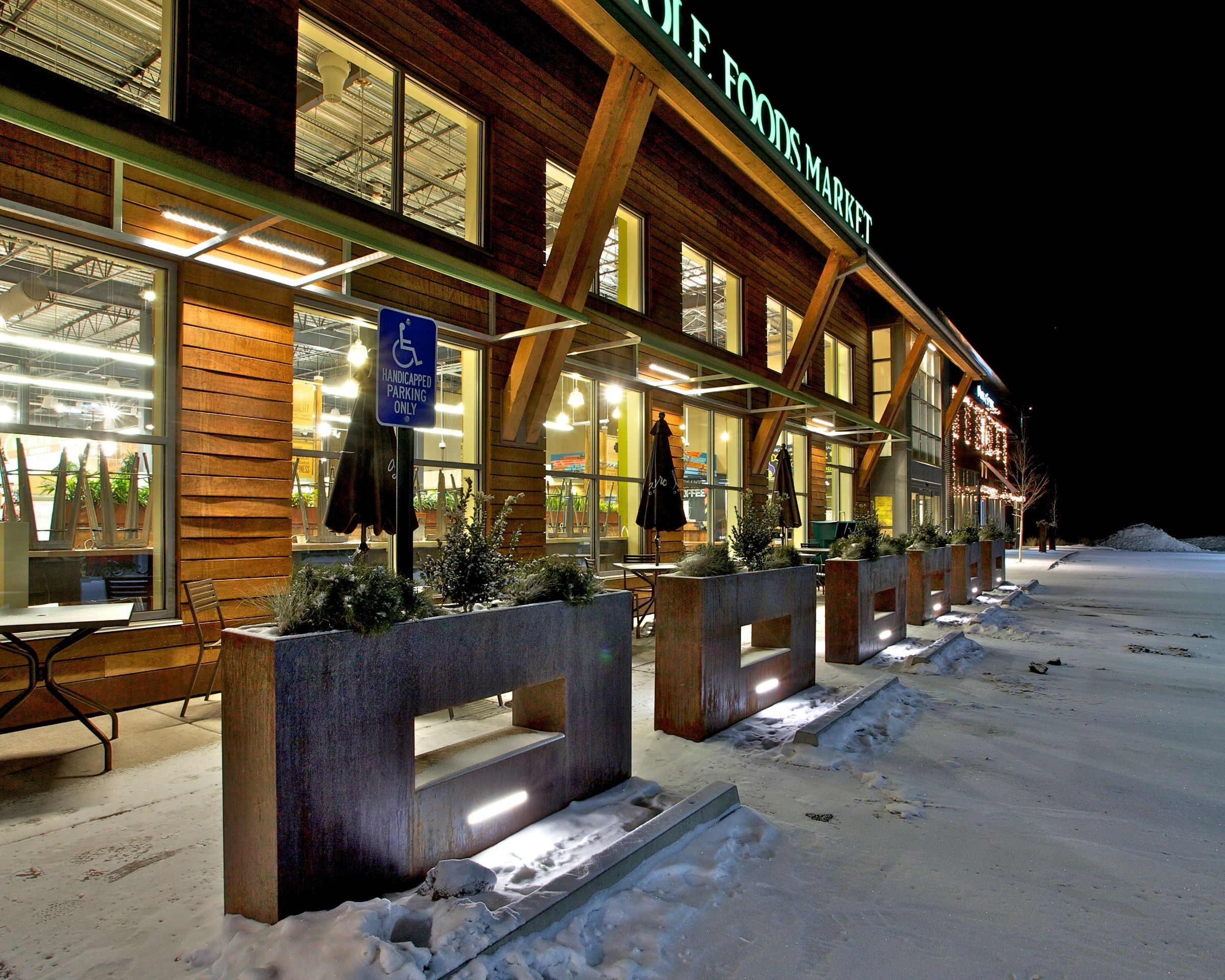 planter lighting. Metal Planters Used As A Parking Lot Barrier For Whole Foods Market Grocery Store Planter Lighting C